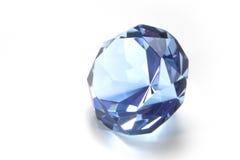 Blue diamond. Clue colored shiny diamond on white background royalty free stock photo