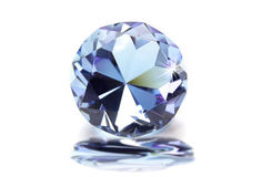 Blue diamond. Clue colored shiny diamond on white background Stock Photography