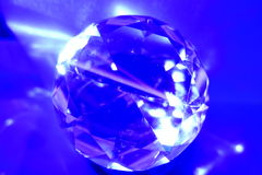 Blue diamond cut orb. Blue globe, orb or sphere with diamond cuts reflecting light Stock Images