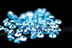 Blue diamonds. On a black background, blue diamonds, the focus is in the middle stock photos