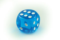 Blue dice. Blue transparent dice on a white background Stock Image