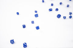 Blue Dice falling on a white background Stock Photo