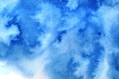 Blue diffused watercolor stains. Vivid blue diffused watercolor stains. Abstract textured background Stock Photos