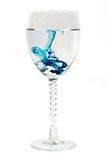 Blue diffusion in a glass. Blue dye diffusion in a wine glass royalty free stock photos