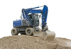 Blue digger on earth pile Stock Images