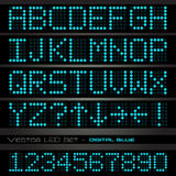 Blue Digital Font. Image of blue digital alphabetic and numeric characters on a dark background Royalty Free Stock Photo
