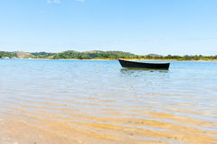Blue dinghy afloat on peaceful calm Ngunguru estuary Northland N. Blue dinghy afloat on peaceful calm Ngunguru estuary in summer holiday destination Northland Royalty Free Stock Images