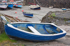 Blue dinghy laid up in a UK harbor Royalty Free Stock Image