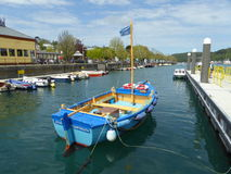 Blue dinghy in harbour royalty free stock photo
