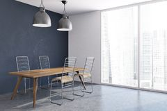 Blue dining room corner, wooden table. Blue dining room interior with a long table, wooden chairs, a concrete floor and two ceiling lamps. A panoramic window. 3d Royalty Free Stock Image