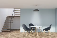 Blue dining room with stairs, round table. Blue dining room interior with stairs, a wooden floor, a round table with chairs. 3d rendering mock up Stock Image