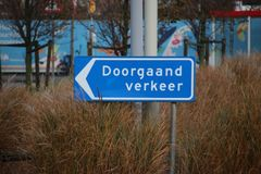 Blue direction sign in the netherlands for ongoing traffic in the harbor of Rotterdam. Blue direction sign in the netherlands for ongoing traffic in the harbor stock photos