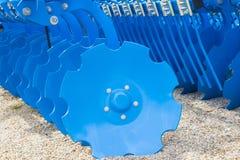 Blue Disc Harrow Trailer for a Farming Tractor Stock Photo