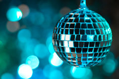 Blue disco ball on bokeh background - horizontal Stock Image