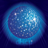 Blue disco ball on dark background. With shining rays of light Stock Image