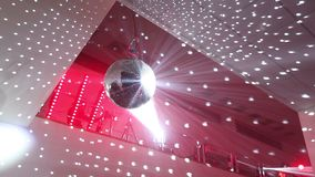 Disco ball at the New Year party, people having fun in the background stock footage