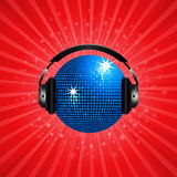 Blue disco ball and headphone on red background Royalty Free Stock Photo