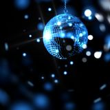 Blue disco ball surrounded by lens flare on a black background Stock Image