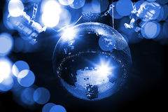 Blue disco mirror ball and lights Stock Photography
