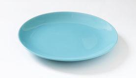 Blue dish. On white background Royalty Free Stock Photo