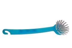 Blue dishes brush. Isolated dishes brush, made of blue plastic Stock Photo