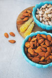 Blue dishes in eastern style with almonds and pistachios Stock Images