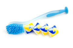 Blue dishwashing brush and tablets Stock Images