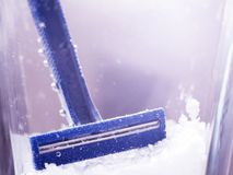 Blue disposable razor in water with bubbles royalty free stock photography