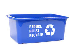 Blue disposal container. Blue plastic disposal container with reduce, reuse, recycle words and recycle symbol over white background Royalty Free Stock Photos