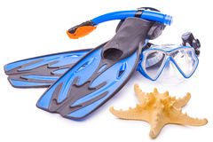Blue diving goggles,snorkel and flippers. isolated. Blue diving goggles,snorkel and flippers on white background stock image