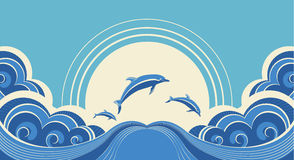 Blue dolphins jumping Stock Photos