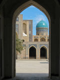 Blue dome through arch. A view through the arch of the mosque with blue dome royalty free stock photos