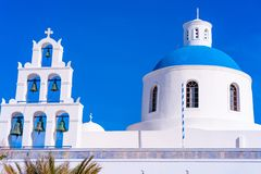 Blue dome and bell tower of Church of Panagia in Oia, Santorini. Cyclades, Greece royalty free stock photo