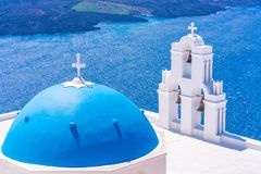 Blue dome and bell tower of famous Agios Theodori Church in Firostefani. Facing Aegean Sea Santorini Greece stock photos