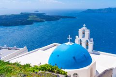 Blue dome and bell tower of famous Agios Theodori Church in Firostefani. Famous Agios Theodori Church with blue dome and bell tower in Firostefani facing Aegean stock image