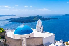 Blue dome and bell tower of famous Agios Theodori Church in Firostefani. Famous Agios Theodori Church with blue dome and bell tower in Firostefani facing Aegean royalty free stock photography