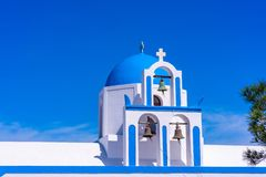 Blue dome and bell tower of whitewashed Greek church near Oia. Blue dome and bell tower of a whitewashed Greek church on the hill near Oia, Santorini, Greece stock photos