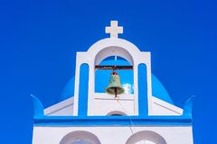 Blue dome and bell tower of whitewashed Greek church near Oia. Blue dome and bell tower of a whitewashed Greek church on the hill near Oia, Santorini, Greece royalty free stock photography