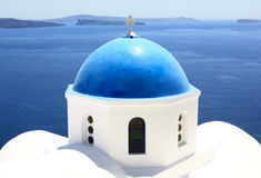 Blue dome of a church. Village of oia in santorini known for its white washed houses and beautiful churches Royalty Free Stock Photos