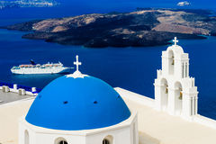Blue Dome Church and Cruise. The most famous blue dome church and cruise at santorini island, greece stock images