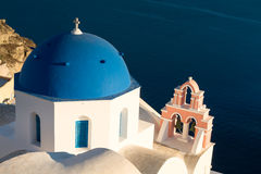 Blue Dome of a church in Oia in the evening light Royalty Free Stock Photography