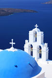 Blue dome Church St. Spirou in Firostefani. On the island of Santorini Greece, overlooking the sea royalty free stock images