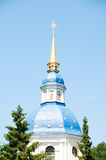 Blue dome with gold stars and a cross against a blue sky.  Royalty Free Stock Photos