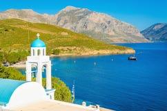 Blue dome of Greek church and sea, Greece Stock Photo
