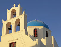 Blue dome greek orthodox church and belltower in Oia on Santorin Stock Photo