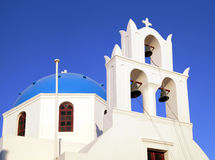 Blue dome greek orthodox church and belltower, Santorini, Greece Royalty Free Stock Photos