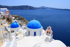 Blue Dome Pink Tower. Oia of Santorini is not just famous in sunset, also a number of white churches and cathedrals with blue dome aside with pink bell tower are Royalty Free Stock Images