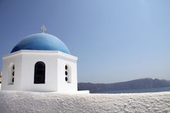 The blue dome of Santorini chapel. The famous blue dome of Panagia Aghion Panton church, at Oia, Santorini, is a very typical architectural piece of the royalty free stock photography
