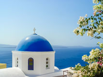 Blue dome of St. Nicholas church in Oia Santorini Stock Images