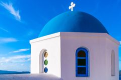 Blue dome of a traditional whitewashed church in Oia, Santorini. Blue dome of a traditional whitewashed church in Oia against blue sky, Santorini, Greece stock photo